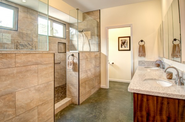 Gorgeous Finishes In A Master Bathroom Include River Rock Stone Floors In  The Shower, Double Sinks, And Two Shower Heads